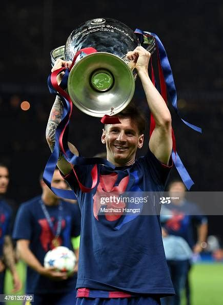 Lionel Messi of Barcelona celebrates with the trophy after ...
