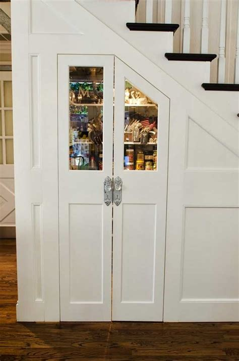 Read on for 16 clever and stylish way to utilize this area in your own home. Organized Pantry Under the Stairs - Decoist