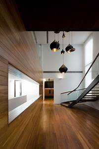 Metallic exterior meets modern interiors at singapore39s for Stylish lighting