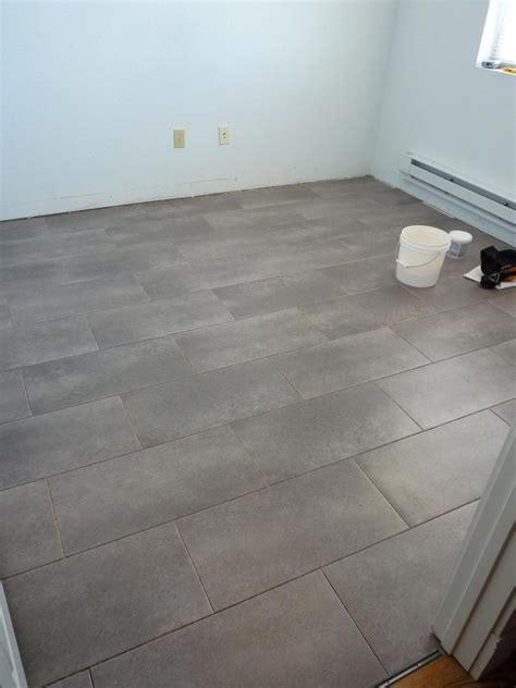 kitchen floor idea trafficmaster ceramica 12 in x 24 in coastal grey vinyl tile flooring 30
