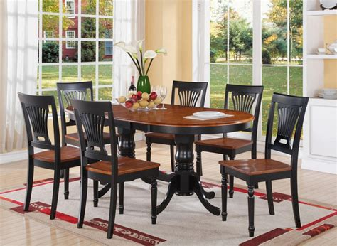 pc plainville oval dining table  wood seat chairs