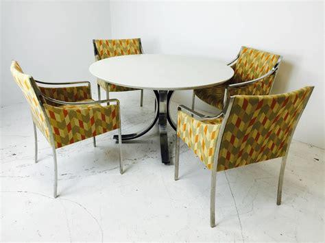 white quartz dining table four legged chrome base round dining table with white