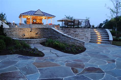 flagstone patio with staircase leading to