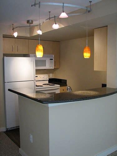 kitchen track lighting ideas lumin 225 rias pendentes no balc 227 o da cozinha viajando no 6318