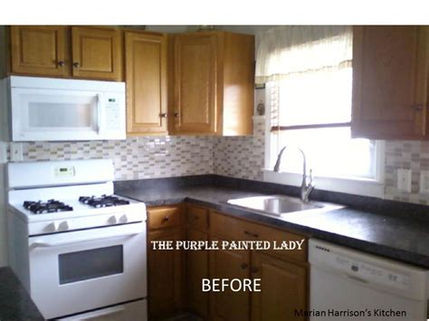 cost to have cabinets painted kitchen cabinet painting the purple painted lady