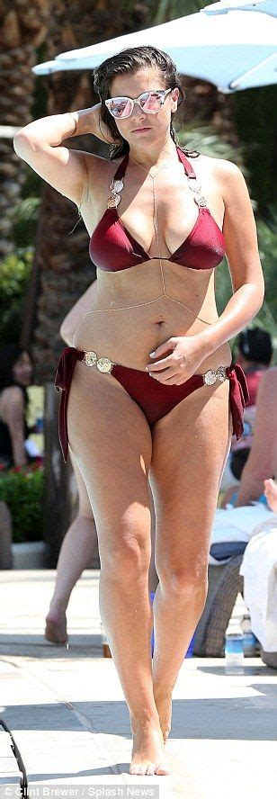 Imogen Thomas flaunts her ample bust in a skimpy burgundy ...