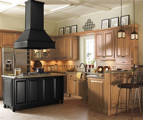 kitchen cabinets with light island light oak cabinets with a black kitchen island masterbrand 9539