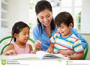 Mother Helping Children With Homework Stock Image - Image ...