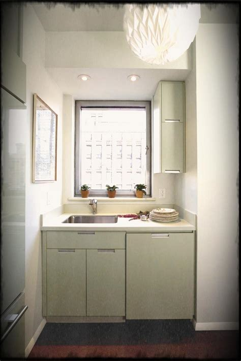 Small Kitchen Ideas With White Cabinet And Glass Window