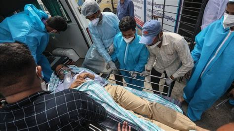 Covid-19: India hospital fire as virus cases hit record ...