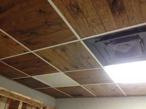 wooden slats replace ceiling tile  paint hangers black