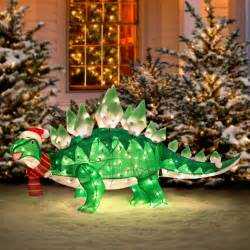 animated stegasaurus dinosaur christmas decoration the green head