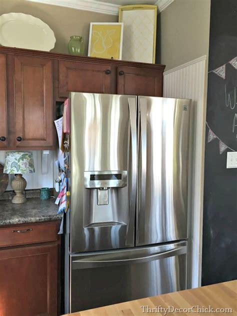 building   fridge  cabinet  top thrifty decor