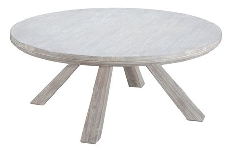 With a softly curved base and two rounded surfaces, this tubular chrome coffee table will help you play up a circle motif and introduce some extra style to a mod or contemporary living room. Beaumont Round Coffee Table - Beach Style - Coffee Tables - by Zuo Modern Contemporary