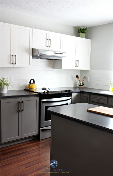 gray owl kitchen cabinets budget friendly kitchen with painted cabinets benjamin 235 | Budget friendly kitchen with painted cabinets. Benjamin Moore Chelsea Gray Gray Owl white subway tile and black laminate countertops with wood flooring. Kylie M Interiors E decor and E design 656x1024