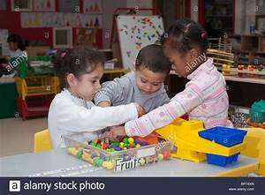 4 year old preschool children playing with toys in the ...