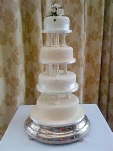 camo cake toppers wedding cake with flowers between tiers onweddingideas