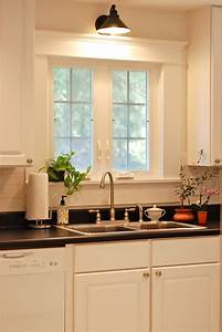 best 25 over sink lighting ideas on pinterest over With kitchen designs with window over sink