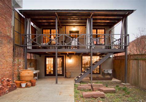 lim home design renovation works metal deck railing deck industrial with brick wall brick patio