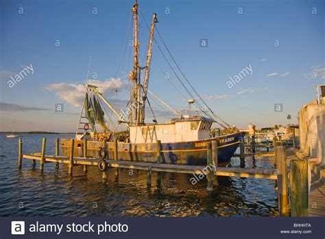 Old Boat Dock by Old Fishing Boat At Dock In Matlacha Florida On The Gulf