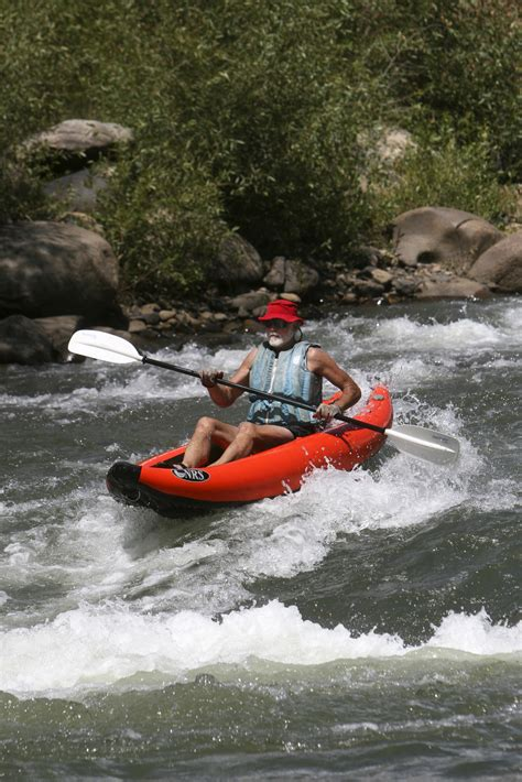 An inflatable kayak on class II rapids near Durango ...
