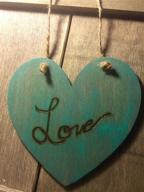 Find the best ideas and designs for 2021! Teal Love wood burned hanging heart teal wall decor   Etsy