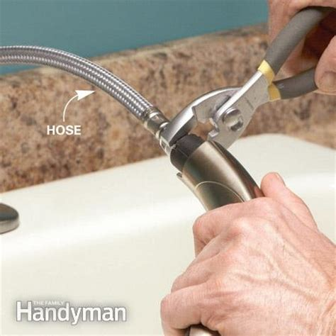 how to replace sprayer hose on kitchen sink running water unclog the aerator the family handyman 9835