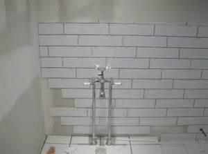 4x16 white subway tiles offset 1 3 2 3 bathroom