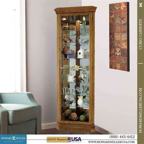 Howard Miller Corner Oak curio Cabinet Glass mirror back