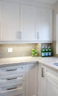 white glass subway tile kitchen backsplash white shaker cabinets smoke gray glass subway tile backsplash neutral quartz countertop ikea