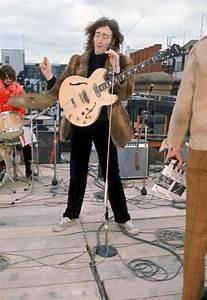 John singing during The Beatles' final public performance ...