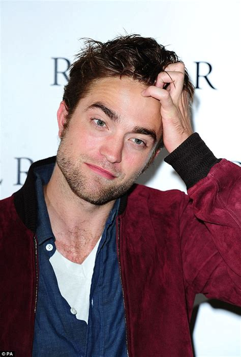 Robert Pattinson looks smoulderingly hot at the London ...
