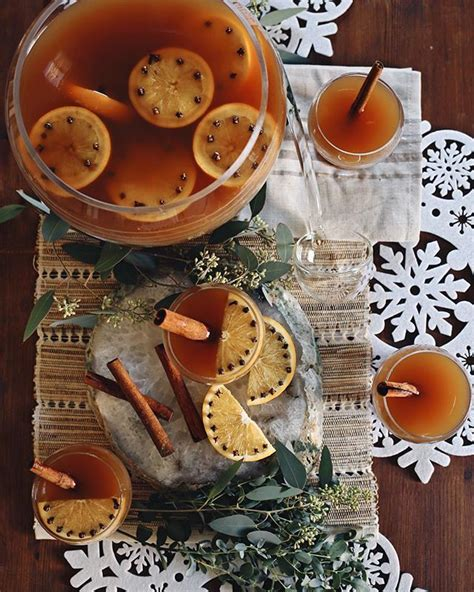 This christmas punch is the perfect drink to serve at any holiday gathering! Holiday Spiced Rum Punch   Warm winter drinks, Favorite thanksgiving, Rum cocktail