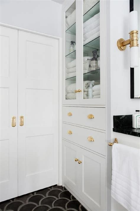 bathroom pocket doors  brass hardware contemporary