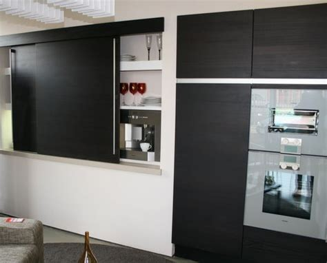 display siematic truffle brown kitchen  floating island worktops  gaggenau appliances