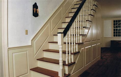 cape codcolonial staircase raised paneling white wash wall cream trim colonial house