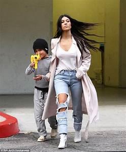 Kourtney Kardashian's son Mason Disick playfully wields ...