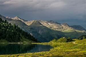 Alpine, Landscape, Dark, Clouds, And, Rays, Of, Sun, On, Green, Meadow, And, A, Small, Lake, Photo, Print, Fine
