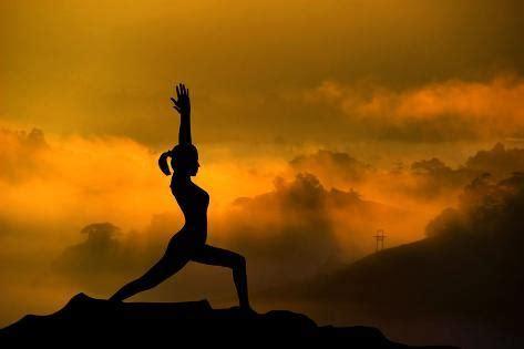 Silhouette Woman Doing Yoga Meditation During Sunrise