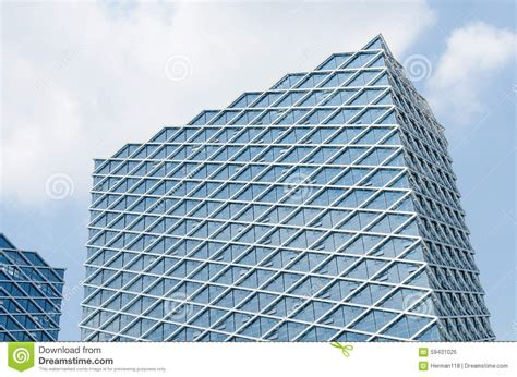 at noon the modern glass curtain wall construction stock