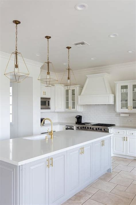 white kitchen light fixtures extra light gray kitchen cabinets with brass ring hardware