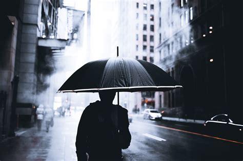 umbrella cityscape mist rain silhouette depth