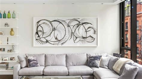 Sofa Paintings by 10 Looks To Hang Above Your Sofa Sugarlift