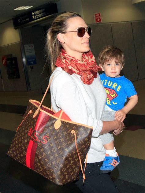 molly sims returns  vacation  customized louis vuitton purseblog