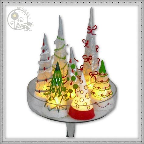 drapey christmas lights tree cones stitchsoup