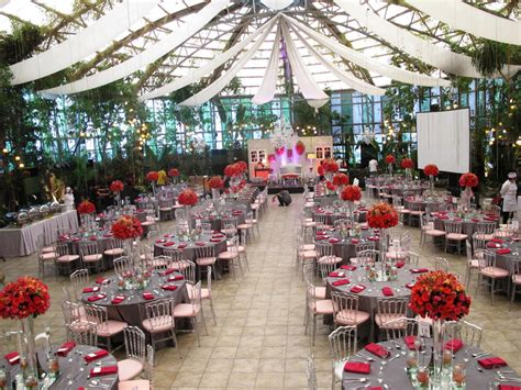 a dramatic and silver themed wedding glass garden