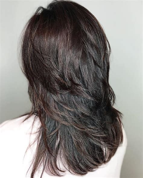 39 Shiny Black Haircut With Flicked Layers Hairstyles