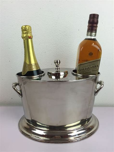 fan with ice compartment a silver plated wine cooler for two bottles with ice