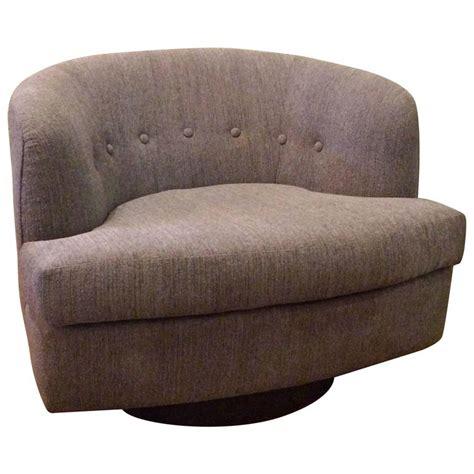 plush low profile barrel shape swivel club chair at 1stdibs
