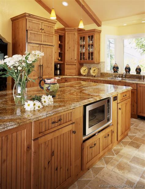 large country kitchen  knotty alder cabinets